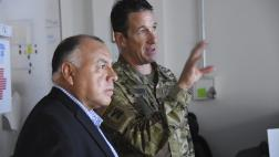 Asm. Rodriguez tours the emergency operations center and received briefing from National Guard member.