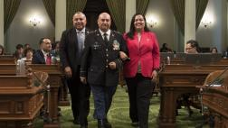 Assemblymember Freddie Rodriguez and Assemblymember Wendy Carillo escort Latino Spirit Award Recipient Hector Barajas